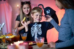 Cheerful kids having fun at Halloween party royalty free stock photography