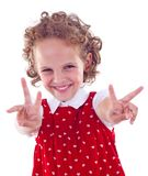 Girl showing victory Stock Photos