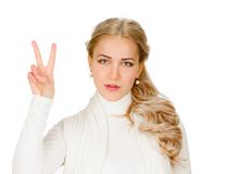Girl showing victory sign Royalty Free Stock Photos
