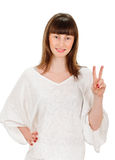 Girl showing victory sign Stock Photography