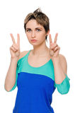 Girl showing victory sign Stock Photos