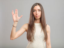 Girl showing Vulcan greeting Stock Photography
