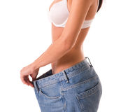 Girl showing weight loss Royalty Free Stock Photos