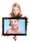 Girl showing woman with cream on tablet. Skin care Royalty Free Stock Photos