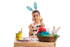 Girl showing yellow Easter egg Stock Images