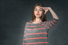 Girl shows anxiety against a dark background Stock Images