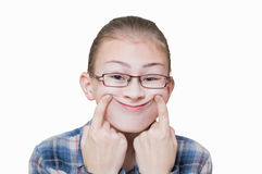 The girl shows an artificial smile,. Isolated on white Stock Photography