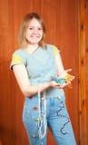 Girl shows beaded cloth Stock Photo