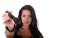 Girl shows brush makeup Royalty Free Stock Photos