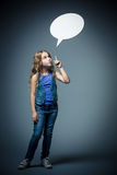Girl shows on the bubble Royalty Free Stock Image