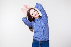Girl shows Bunny hands. Beautiful girl shows Bunny hands Royalty Free Stock Photography