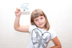 Girl shows card with WIFI sign. Little girl show in right hand card with WIFI sign Royalty Free Stock Photo