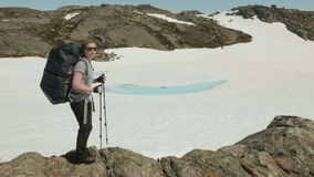 Girl shows the direction of the movement in mountains stock video footage