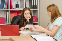 Girl shows a document tired office specialist Stock Photography