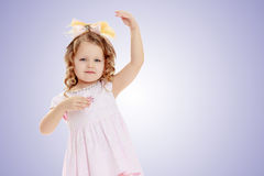 Girl shows the doll. Stock Photography
