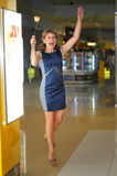 Girl shows emotions. Girl jumping up in the mall Stock Photo