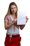 Girl shows empty sheet of a white paper Royalty Free Stock Photos