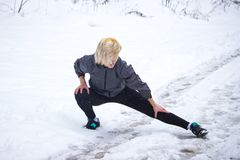 The girl shows exercise a twine in the winter Stock Photo