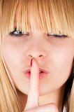 Finger gesture at the lips Stock Photo