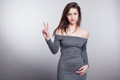 Girl shows 2 finger victory Royalty Free Stock Image