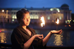 A girl shows a fire show in the night Royalty Free Stock Photography