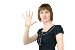 The girl shows five fingers Stock Images