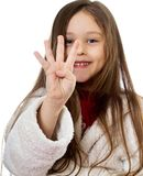 Girl shows four fingers. Little cute girl shows four fingers Stock Photo