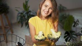 Girl Shows Fresh Broccoli stock footage