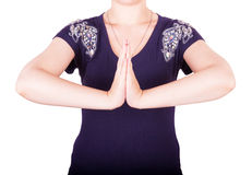 Girl shows gesture namaste Royalty Free Stock Photo
