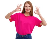 A girl shows gesture ok with both hands. Isolated on white background. stock photo