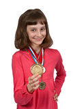 Girl shows gold medal Stock Photography