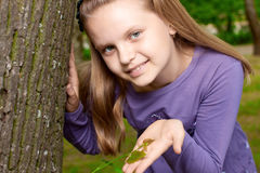 Girl shows green shoot of tree Royalty Free Stock Image