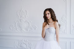 Girl shows hairstyle. Cheerful bride holding her curly hair. Stock Photography