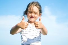 Girl shows  hand sign Stock Photo