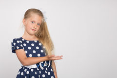 Girl shows a hand to the side Royalty Free Stock Photo