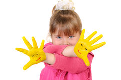 The girl shows the hands painted in a yellow paint Royalty Free Stock Photo