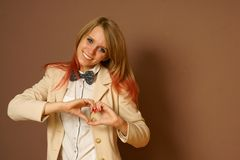 Girl shows heart Stock Photography