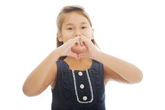 Girl shows hearts on hands Stock Image