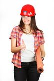 A girl shows in the helmet of builder, that all will be good Royalty Free Stock Images