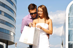 Girl shows her boyfriend to buy Royalty Free Stock Photography
