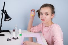 Girl shows her container with lenses for better eyesight royalty free stock photos