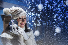 Girl shows her gift snowball Royalty Free Stock Photos
