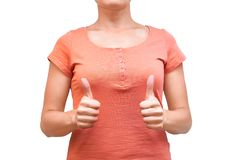 Girl shows her hand gesture thumb up. Isolated on white background Stock Photo
