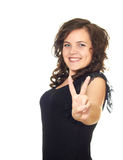 Girl shows her hands a symbol of victory. Isolated on white background Royalty Free Stock Image