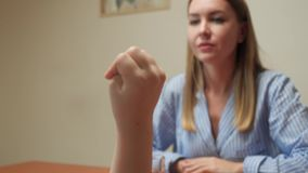 The girl counts on the fingers. Girl shows her mother how to count on fingers stock video footage
