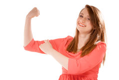 Girl shows her muscles strength and power. Funny teen girl happy young woman shows her muscles isolated on white background. Strength and power concept Stock Images
