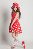 Girl shows her red dress Stock Images