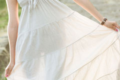 The girl shows her silhouette through the dress. Stock Photo