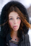 Girl shows her tongue Royalty Free Stock Photo