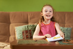 Girl shows his drawing Royalty Free Stock Image